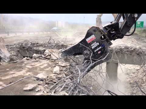 Watch the GDR (Genesis Demolition Recycler) up close while demolishing a bridge.