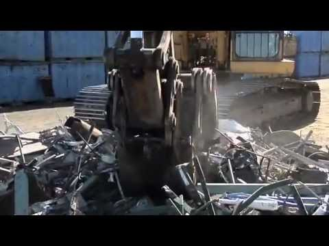 Watch the GSD (Genesis Severe-Duty Grapple) move a scrap pile with ease.